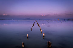 Wooden structures at the salt lakes long exposure.  Stock Photography
