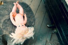 Wooden stub with a plastic doll. royalty free stock images