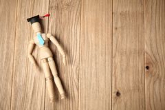 Wooden student figure, training and education stock images