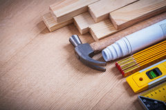 Wooden studs blueprints instruments of measurement Royalty Free Stock Image