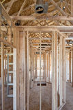 Wooden studs and elsecrical in new home construction Royalty Free Stock Images