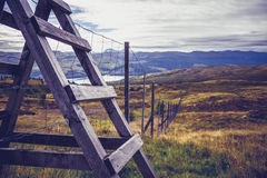 Wooden style and fence in mountain landscape Stock Photos