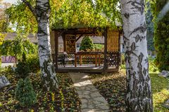 Wooden summer house in the garden Royalty Free Stock Images