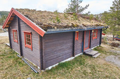 Wooden summer house, Norway. Gautefall, Norway - May 2, 2015: Norwegian residential building with a green roof, for rentf. Early spring, around the coniferous stock images