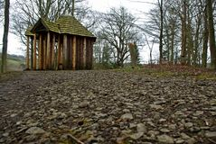 Wooden summerhouse on a  forest path Royalty Free Stock Image