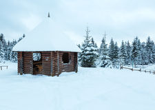 Wooden summerhouse on winter hill top. Royalty Free Stock Photography