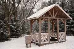 Wooden summerhouse. At the winter season. Sepia toned Royalty Free Stock Image