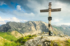 Wooden summit cross and summer colors in mountains. Bavarian Alps. Royalty Free Stock Photography