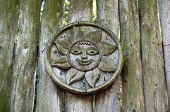 Wooden sun on antique fence. Carving with wooden sun on the antique fence Royalty Free Stock Photography