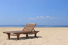 Wooden sun bed. On the beach stock photos