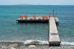 A wooden sun deck into the sea royalty free stock photo