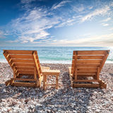 Wooden sun loungers on Adriatic Sea coast Stock Image