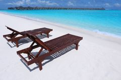 Wooden sun loungers on sea beach. In summer day stock photo