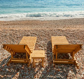Wooden sun loungers on the Sea coast Stock Photography