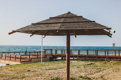 Wooden sun umbrella on the beach. Summer travel concept. royalty free stock images