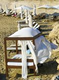 Wooden sunbeds on sandy beach royalty free stock images