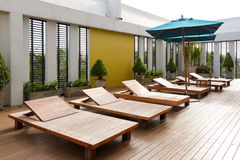 Wooden sunbeds. Royalty Free Stock Photography