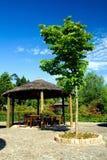 Wooden sunshade on a resort garden Royalty Free Stock Photos