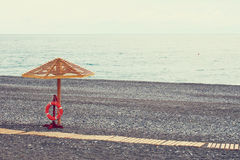 Wooden sunshade on the sea beach Royalty Free Stock Photo