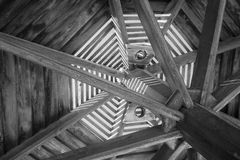 Through wooden sunshade see the sky black and white close-up of Stock Photography