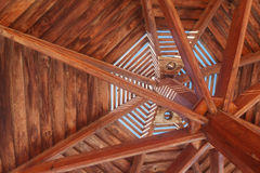 Through wooden sunshade see the sky close-up Stock Photos
