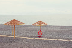 Wooden sunshades on the sea beach Royalty Free Stock Photography