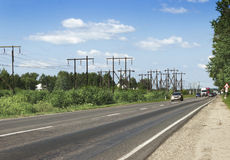 Wooden supports  electrical line along highway Stock Images