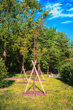 Wooden supports for young trees. Young trees fortified posts from boards Royalty Free Stock Photography