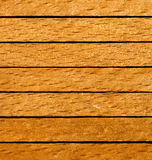 Wooden surface of a board. Sample of the abstract background from wooden rod Stock Photos