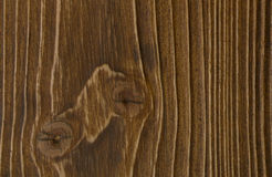 Wooden surface of brown color. Is easily visible texture of dark wood Stock Photos