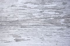 Wooden surface with cracks and peeling white paint royalty free stock images