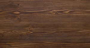 The wooden surface is dark brown color. Is easily visible texture of dark wood Royalty Free Stock Photo