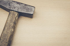 On a wooden surface hammer Royalty Free Stock Photos