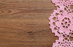 Wooden surface with lace. Wooden surface with the crochet lace on the edge Stock Images