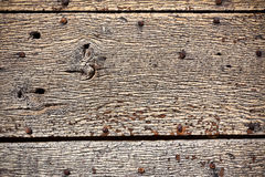 Wooden surface with old metal rivets background Royalty Free Stock Photography