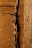 Wooden surface and old rope. Close up of wooden surface and old rope Royalty Free Stock Photos