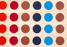 Wooden surface painted with colored circles. Abstract background of a wooden surface painted with colored circles Stock Image