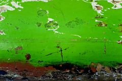 Wooden surface painted in green color, peeling paint, rough texture background, old wood Board,a fragment of old Stock Photo