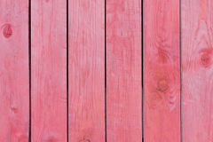 Wood texture, background of wood boards painted with stain. Wooden surface. Pink painted wood board texture and background. Pink natural wooden background stock photography