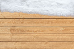 Wooden surface with snow on one side Stock Photo