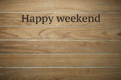 Happy weekend on wooden background. Wooden surface is stamped with Happy weekend background with copy space royalty free stock photography