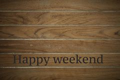 Happy weekend on wooden background. Wooden surface is stamped with Happy weekend background with copy space royalty free stock image