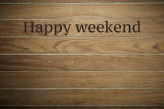 Happy weekend on wooden background. Wooden surface is stamped with Happy weekend background with copy space stock photography