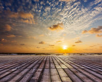 Wooden surface under sunset sky Royalty Free Stock Photo