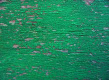 a wooden surfaceold cracked green paint on stock images