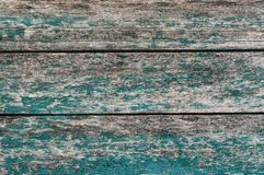 Wooden surfase with horizontal boards and cracked blue green paint stock photography