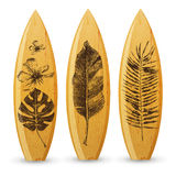 Wooden surfboards with hand drawn tropical leaves Royalty Free Stock Photography