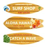 Wooden surfboards. 3 wooden surfboards with prints and different type designs Royalty Free Stock Images