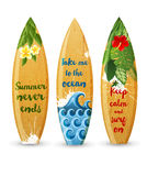 Wooden surfboards with type designs. 3 wooden surfboards with prints and different type designs Royalty Free Stock Images