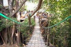 Wooden suspension bridge in forest Stock Photos